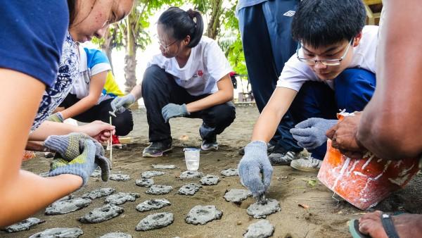 Volunteers making coral substrates